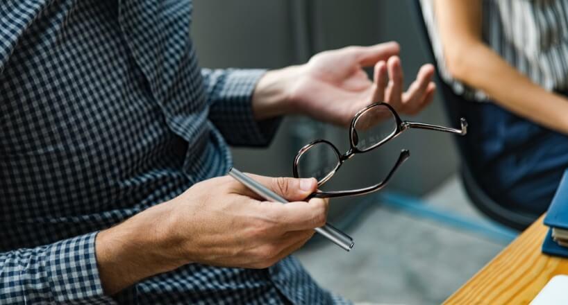 Man holding glassesx