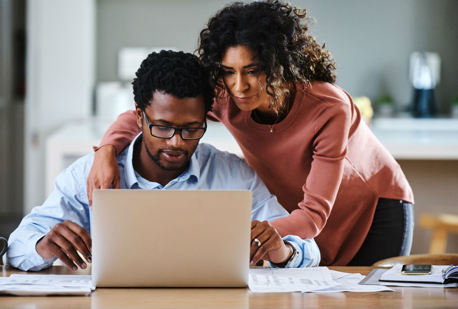 Couple looking through the SMI Adviser Knowledge Base
