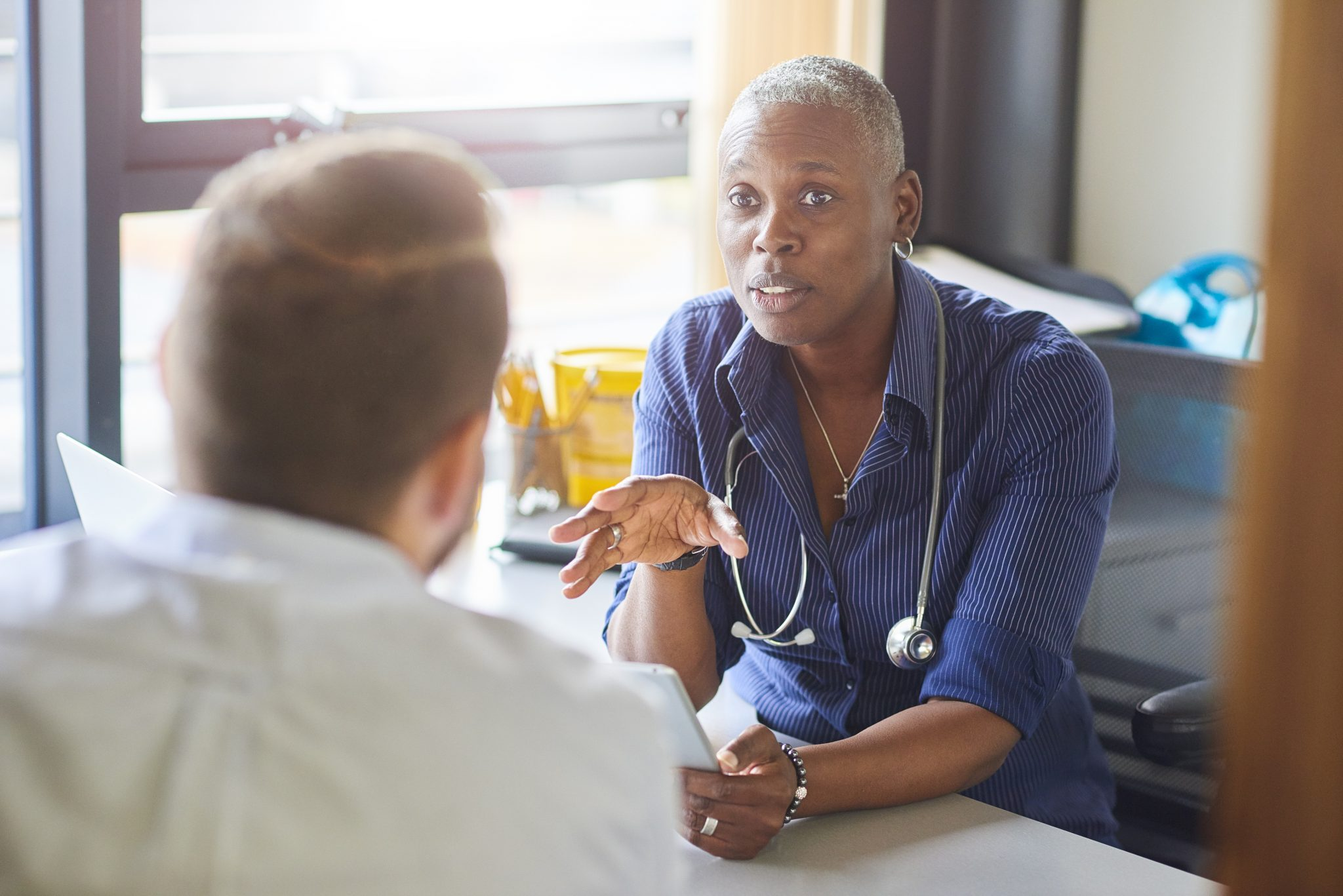 A clinician discusses a treatment plan provided on SMI Adviser.